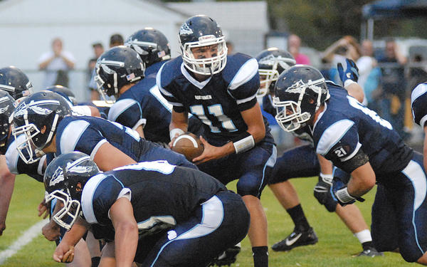 Petoskey sophomore quarterback Evan Whitmore (11) takes the snap during the first half of Friday's non-league game against Hastings at Curtis Field. The Northmen defeated the Saxons, 41-14, to move to 2-0.