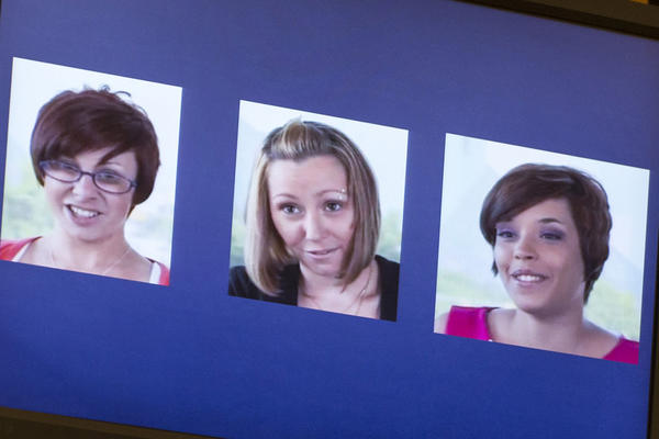 A screenshot from a video released by the three victims of Ariel Castro, (L-R) Michelle Knight, Amanda Berry and Gina DeJesus, is displayed during Castro's sentencing at the Cleveland Municipal Courthouse on August 1, 2013 in Cleveland, Ohio. Castro was sentenced to life without parole plus one thousand years for abducting the women between 2002 and 2004 when they were between 14 and 21 years old.