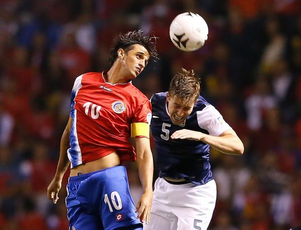 Costa Rica's Bryan Ruiz battles for a header against Matthew Besler.