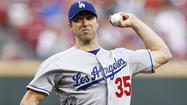 Dodgers, on road to playoffs, hit a speed bump in 3-2 loss to Reds
