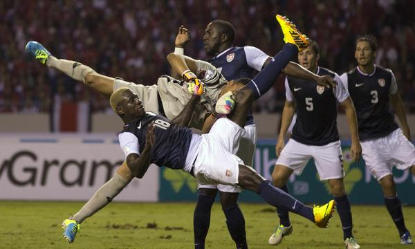 U.S. forward Eddie Johnson, front, collides with Costa Rica goalkeeper Keylor Navas, who blocked Johnson's attempt to score during USA's 3-1 loss Friday.