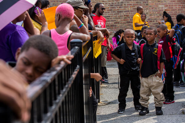 Students wait for their parents after classes at Curtis Elementary on the first day of school for CPS students in Chicago Aug. 26, 2013.