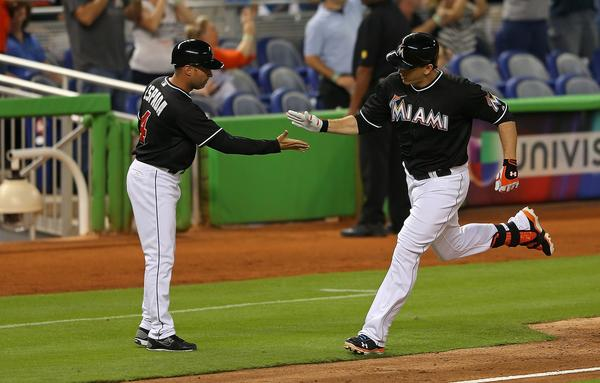 MIAMI, FL - SEPTEMBER 06: Logan Morrison #5 of the Miami Marlins high fives third base coach Joe Espada #4 after hitting a two run home run in the second inning during a game against the Washington Nationals at Marlins Park on September 6, 2013 in Miami, Florida. (Photo by Mike Ehrmann/Getty Images) ORG XMIT: 163495390