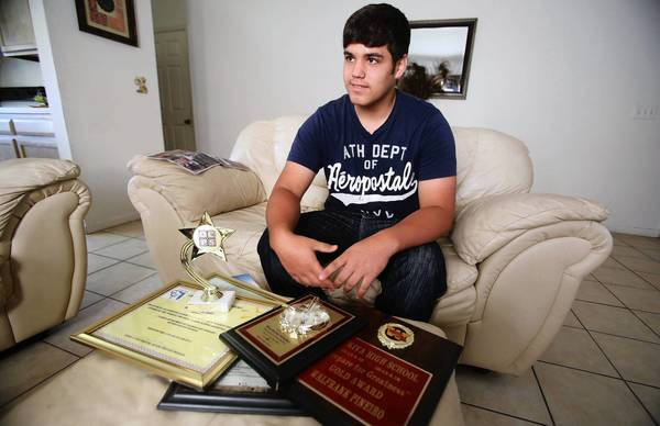 Wekiva High School junior Walfrank Pieiro shows off some of the awards he has won, on Tuesday, August 6, 2013. Walfrank, who has been in the United States after moving from Cuba about two years ago, is an honor roll student and star pitcher for his high school. An academic mentor of his thinks he would have passed if the test (FCAT) was translated into Spanish, as about a dozen other states do.