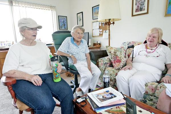 From the left, Bonnie Cantrell, Norma Bowman and Barbara Scott-Laing talk on Tuesday, August 27, 2013 about the upcoming closure of the Twelve Oaks retirement facility.