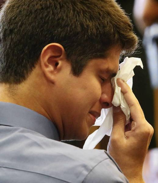 Alejandro Correa, 20, wipes tears as his parents speak Friday, August 30, 2013 during his plea hearing in a Orange County courtroom. Correa received a sentence of 6 years in prison for the death of newlyweds Giselle Batista,24, and Benjamin Frias,30, who were stopped at a redlight when deputies said Correa slammed into them from behind while driving drunk.