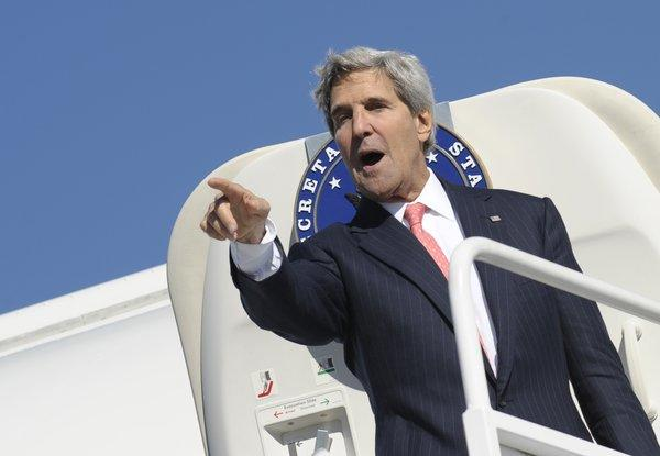 U.S. Secretary of State John Kerry boarding his plane at Vilnius International Airport in Vilnius, Lithuania, on Saturday. Kerry sought to muster European Union support for military strikes against Syria.