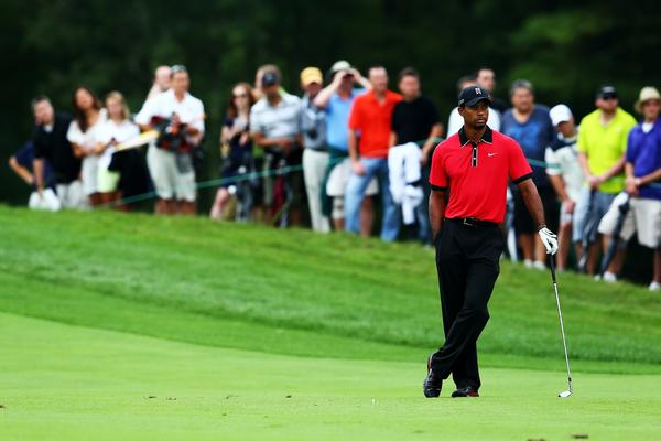 Tiger Woods looks on from the 13th fairway during the final round of the Deutsche Bank Championship at TPC Boston.