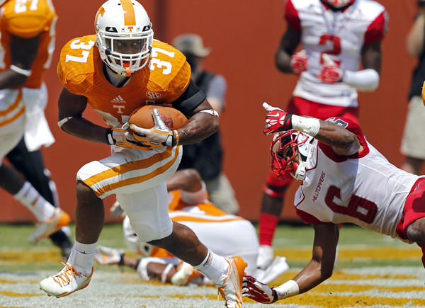 Tennessee defensive back Brian Randolph (37) avoids Western Kentucky receiver Joel German (6) after intercepting a pass in the second quarter Saturday.