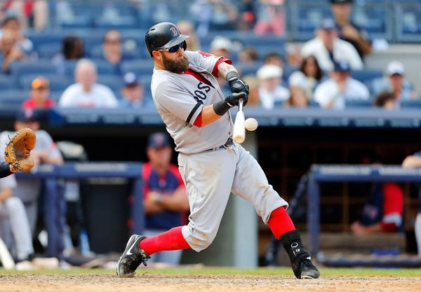 Mike Napoli of the Red Sox connects on a ninth-inning home run at Yankee Stadium on Saturday. It was his second homer of the game.
