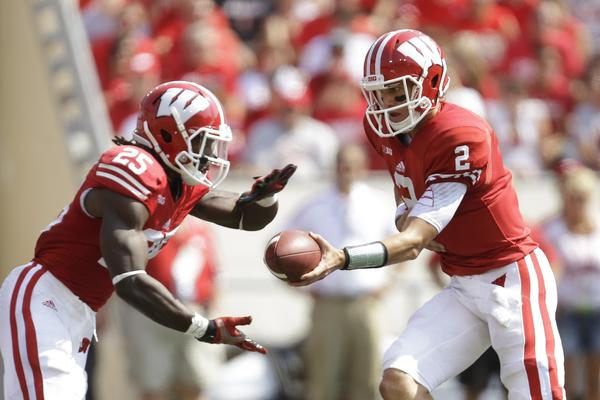 Joel Stave hands off to Melvin Gordon during the game against Tennessee Tech.