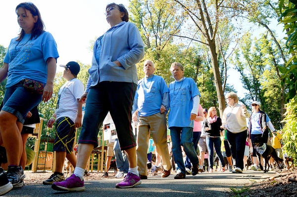 Participants in the Out of the Darkness Community Walk leave City Park Saturday morning. The walk was part of suicide prevention month.