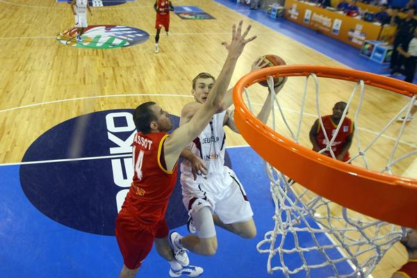 Sacha Massot of Belgium defends against Niels Giffey of Gemany during the FIBA European Championships in Slovenia. Giffey, of UConn, is the youngest player on Germany's team.