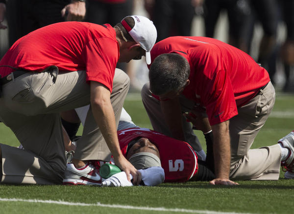 Ohio State quarterback Braxton Miller is tended to by team medical staff after being injured on a play against San Diego State.