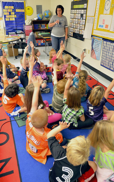 Sharpsburg Elementary School second grade teacher, Erin Harrell, engages her students Friday morning in their classroom in the main school building.