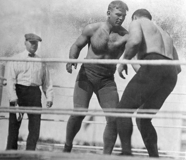 "Sparring for advantage, World Champion wrestler Frank A. Gotch, center, advances on George ""the Russian Lion"" Hackenschmidt early in their title bout in White Sox Park on Sept. 4, 1911. Gotch won the match."