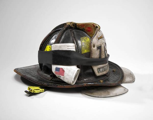 "The helmet of surviving FDNY Engine 16 firefighter Mickey Kross is among the artifacts featured in the book ""The Stories They Tell."""