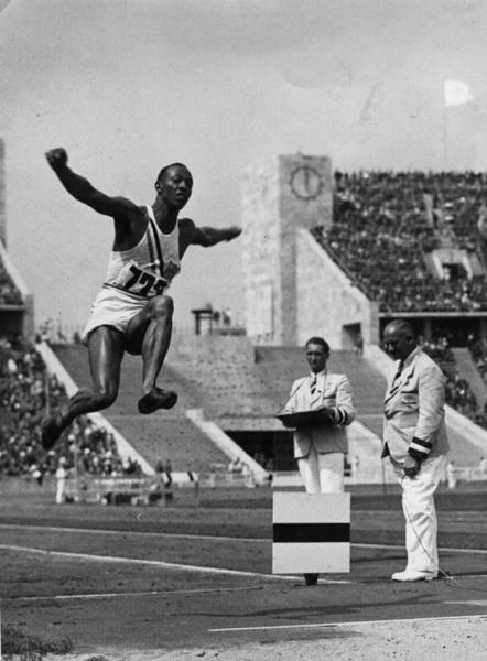 Jesse Owens flies through the air during the long jump event at the Olympic Games in Berlin.