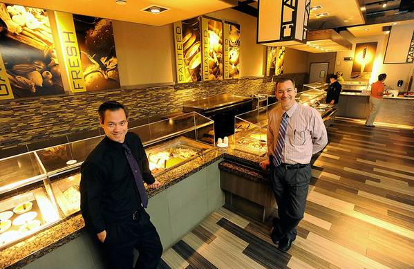 John Finlay, assistant general manager (left) and Michael Fox, general manager (right) show off the new Steelworks Buffet and Grill at the Sands Casino Resort Bethlehem. The restaurant opened Aug. 8.