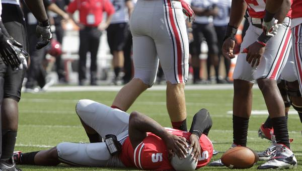 Ohio State quarterback Braxton Miller lies on the field after injuring his knee against San Diego State on Saturday.