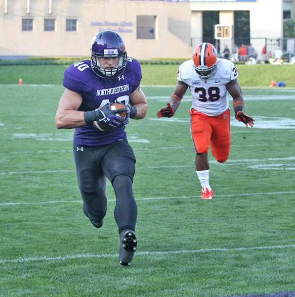 Northwestern's Dan Vitale scores a touchdown in front of Syracuse linebacker Cameron Lynch during the first half.