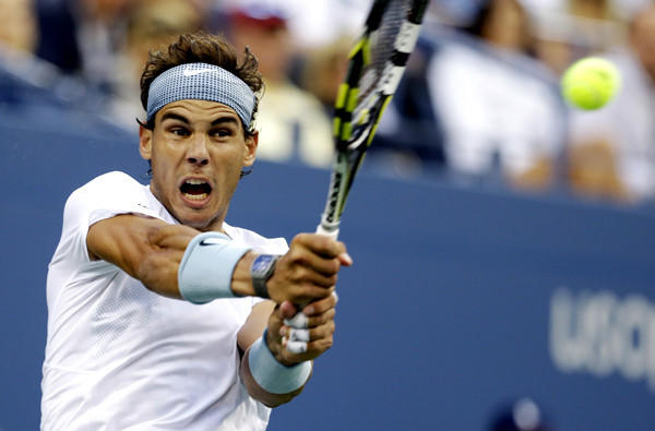 Rafael Nadal gets into a backhanded return in his semifinal match against Richard Gasquet on Saturday at the U.S. Open.