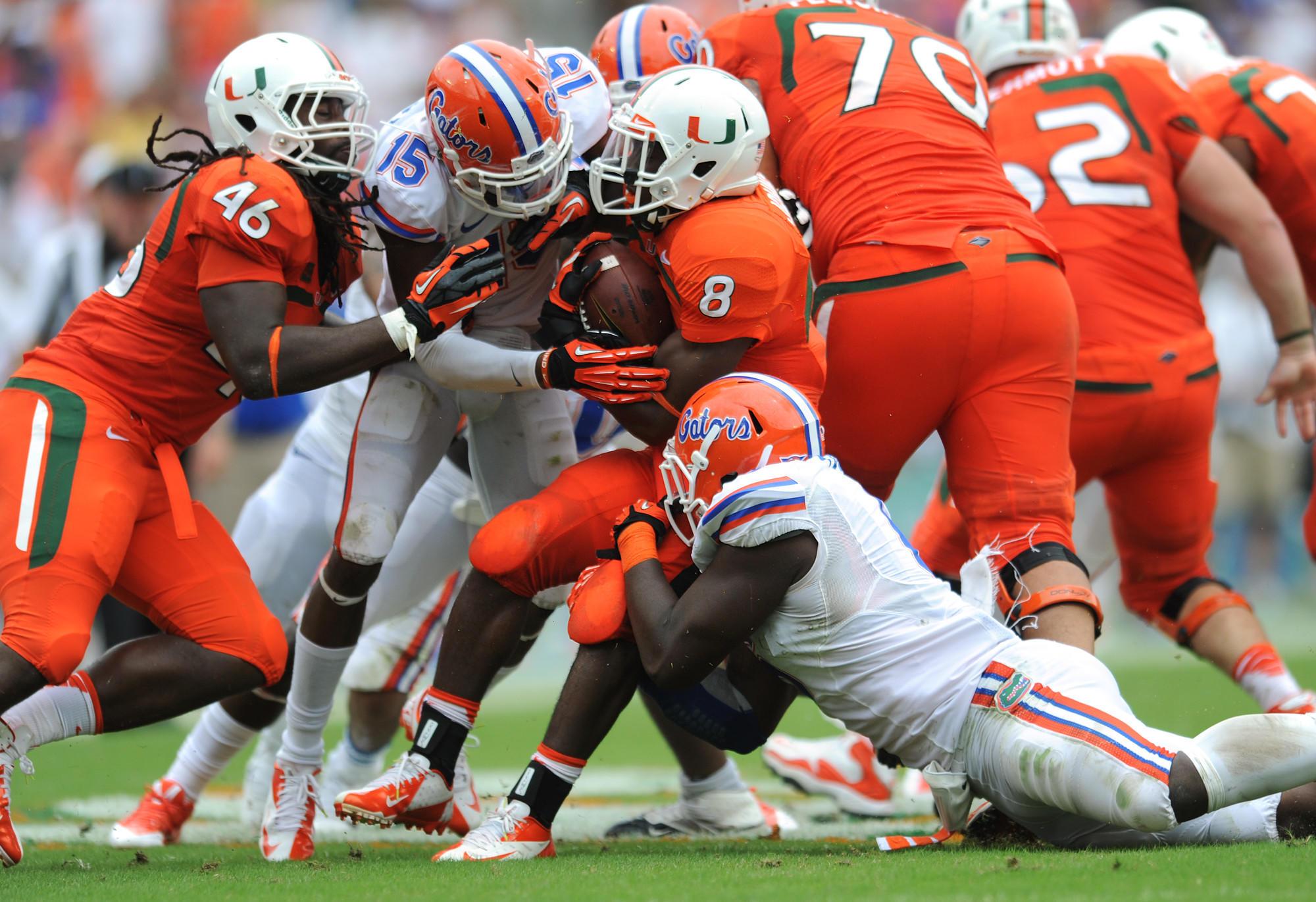 Duke Johnson gets bottled up by the Florida defense in the second half. University of Florida vs. University of Miami. Sun Life Stadium, Miami Gardens, FL 9/7/13. Jim Rassol, Sun Sentinel..