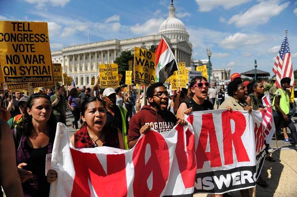 Hundreds of demonstrators opposed to a U.S. military strike against Syria protest outside the Capitol in Washington.