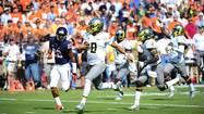 Oregon sprints past Virginia in resounding 59-10 victory