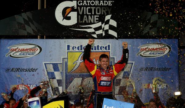 Carl Edwards celebrates after winning Saturday's NASCAR Sprint Cup race at Richmond International Raceway.