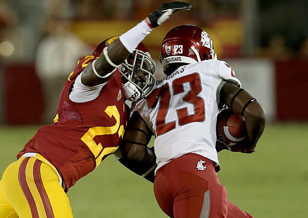 USC safety Leon McQuay, left, tries to strip the ball from Washington State punt returner Leon Brooks, who fumbled it out of bounds in the first quarter of the Trojans' 10-7 loss Saturday.
