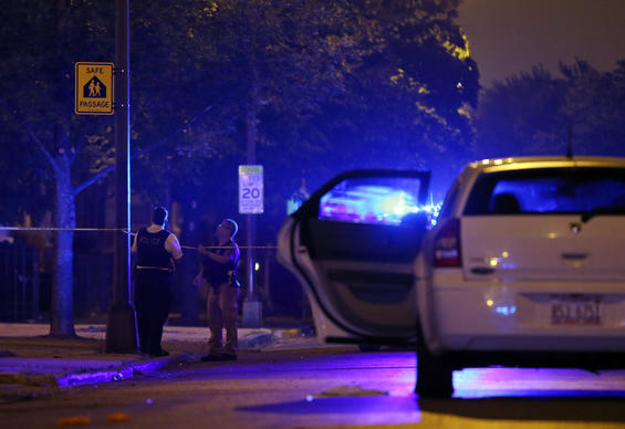 Chicago Police officers investigate the scene where a motorist stopped after being shot, at the corner of Wilcox St. and Pulaski Road on Sept. 8.