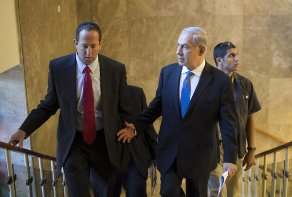 Israeli Prime Minister Benjamin Netanyahu, right, arrives at the weekly Cabinet meeting in his Jerusalem office on Sunday.
