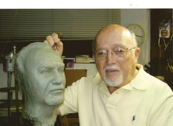 Gerson Frank works on a bust of his partner, William Aberbach.