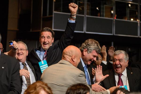 Actor William Baldwin (2-L), members of the International Federation of Associated Wrestling Styles (FILA) and supporters of the wrestling bid, celebrate after the International Olympic Committee (IOC) announced that wrestling won the bid to fill the final sports slot left vacant for the 2020 Olympic Games, during the IOC's 125th Session, in Buenos Aires.