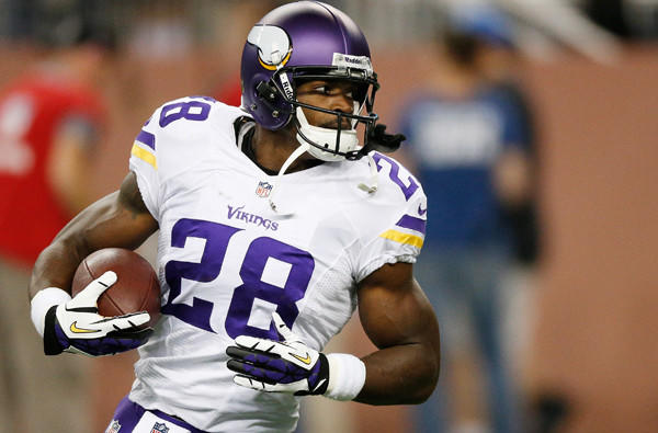 Minnesota Vikings running back Adrian Peterson warms up before the game against the Lions on Sunday in Detroit.