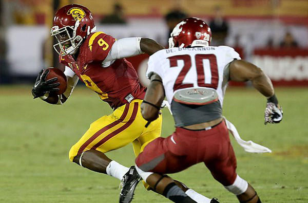 USC receiver Marquise Lee reverses field for extra yardage after making a catch against WSU defender Deone Bucannon during the third quarter Saturday night at the Coliseum.