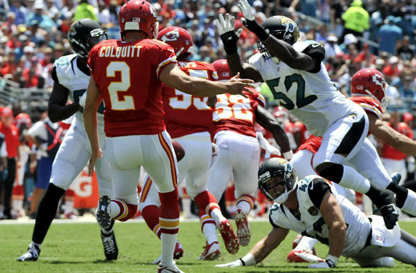 Jaguars linebacker J.T. Thomas (52) is about to block a punt by the Chiefs' Dustin Colquitt in the first half Sunday in Kansas City.