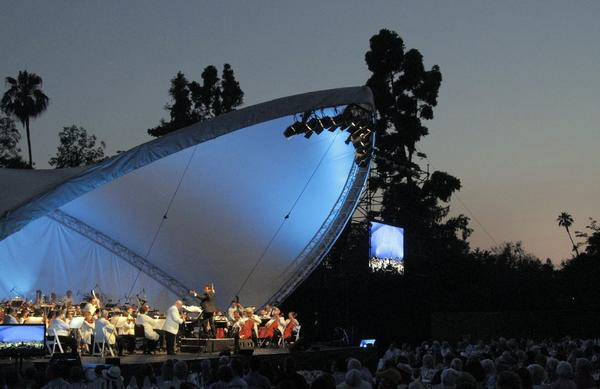 The Pasadena Pops plays in June at the Los Angeles County Arboretum, the first of the concerts conducted by Michael Feinstein.
