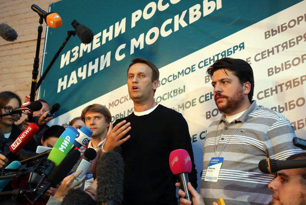 Opposition leader Alexei Navalny speaks to reporters shortly after the polls closed in Sunday's mayoral election in Moscow.