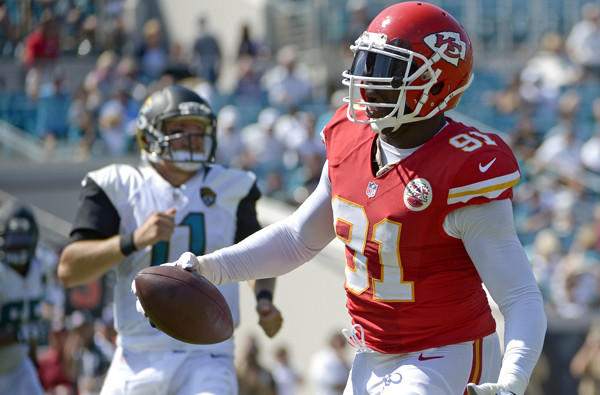 Chiefs linebacker Tamba Hali (91) runs into the end zone for a touchdown after intercepting a pass from Jaguars quarterback Blaine Gabbert (11) in the second half Sunday in Jacksonville, Fla.