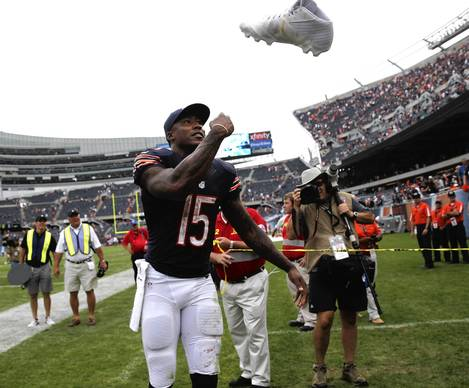 Brandon Marshall celebrates by throwing his shoes into the stands.