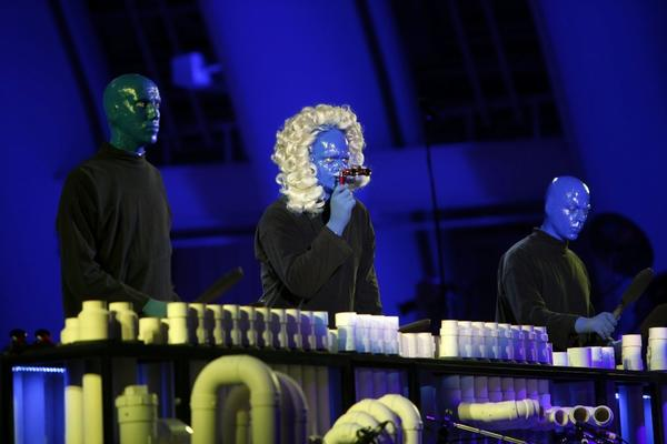 The members of Blue Man Group play a percussion instrument made out of PVC pipe as they rehearse for their first performance at the Hollywood Bowl.