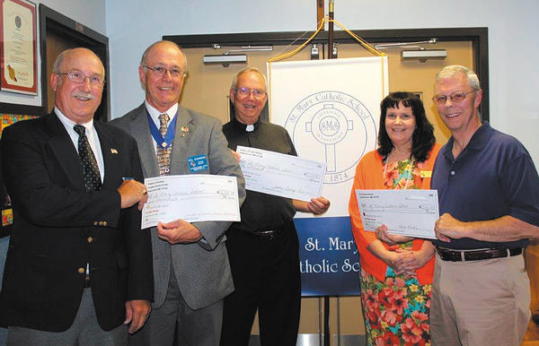 From left, John Danko, deputy grand knight; Cel Shannon, grand knight; the Rev. George Limmer; Patricia McDermott, St. Mary Catholic School principal; and Robert Rankin participate in a check presentation.