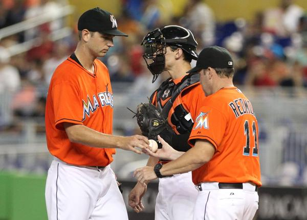 MIAMI, FL - SEPTEMBER 08: Manager Mike Redmond #11 (R) removes Pitcher Jacob Turner #33 of the Miami Marlins from the game against the Washington Nationals at Marlins Park on September 8, 2013 in Miami, Florida. (Photo by Marc Serota/Getty Images) ORG XMIT: 163495426