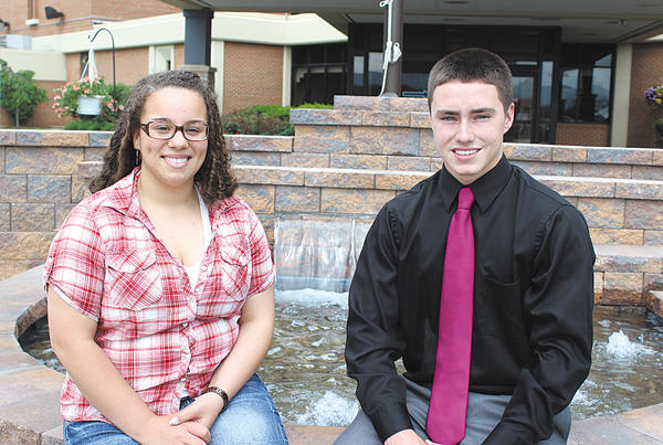 Landis Health Professions Scholarship recipients Searra Carter, left, and Gage Hurlburt are pictured in front of the fountain outside the main entrance to the Berkeley Medical Center in Martinsburg, W.Va.