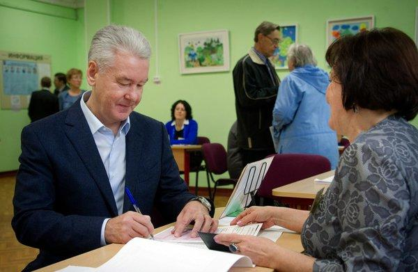 Acting Mayor Sergei Sobyanin gets his ballot at a polling station during a mayoral election in Moscow on Sunday. Sobyanin later declared victory.