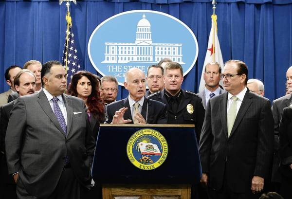 Gov. Jerry Brown announces a $315-million proposal to reduce California's prison population. With him are Assembly Speaker John A. Prez, left, and Senate Minority Leader Bob Huff, right.