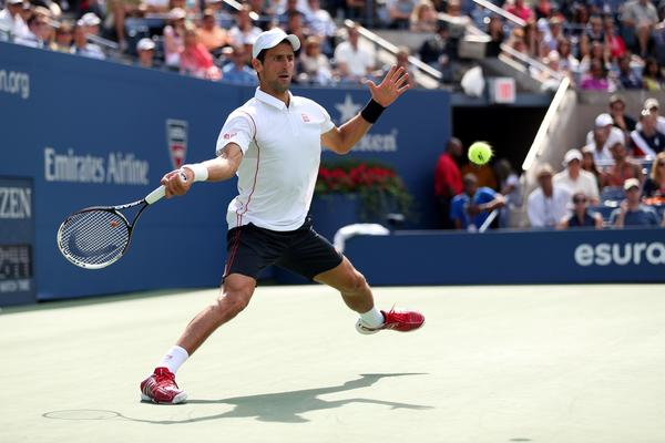 Novak Djokovic plays a forehand during his men's singles semifinal match.