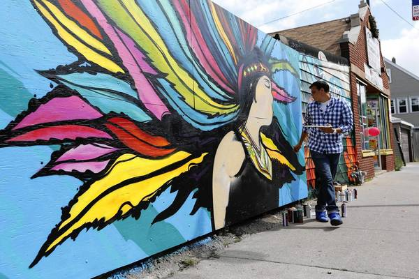 "Epifanio Monarrez, seen working on a mural in the 3800 block of West 31st Street, said ""not everybody can understand typical graffiti or letters, but they can understand art and images which I strive to do now."""